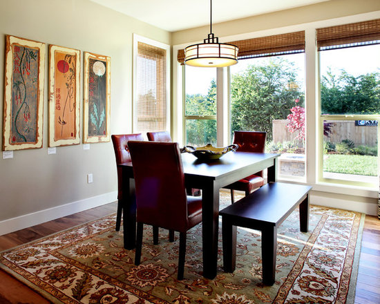 Eclectic Dining Room With Windows