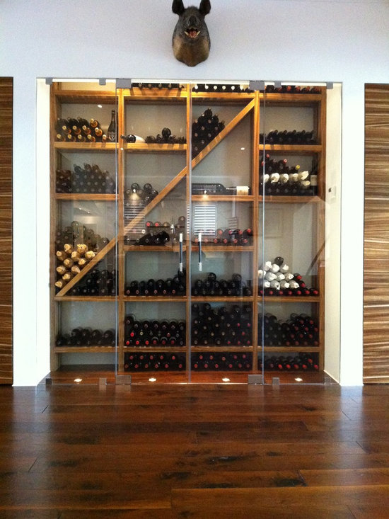 Contemporary Wine Cellar With Refrigeration By Kessick
